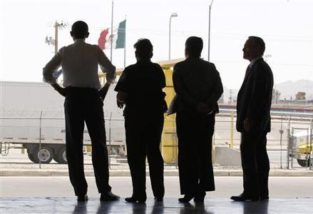 President Barack Obama (L) looks over to Mexico during a tour of Bridge of America Cargo Facility in El Paso, Texas, May 10, 2011. REUTERS/Jim Young