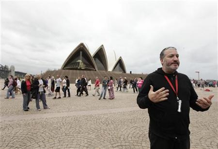 U.S. artist Spencer Tunick talks to members of the media as after photographing naked volunteers in front of the Sydney Opera House March 1, 2010. REUTERS/Tim Wimborne