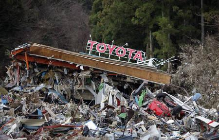 A file photo shows a Toyota dealership is seen at a devastated area after the earthquake and tsunami, in Minamisanriku town, Miyagi prefecture, March 22, 2011. Japan's 9.0 magnitude earthquake hit Toyota's quarterly profits harder than expected. REUTERS/Carlos Barria/Files