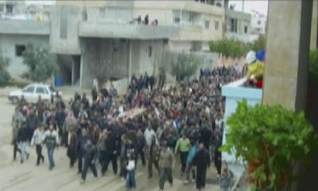 Syrians take part in a funeral procession in Deraa March 24, 2011, in this still image taken from video footage.  REUTERS/Stringer