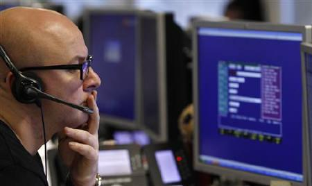 A trader monitors the screen on a trading floor in London January 22, 2010. REUTERS/Stefan Wermuth/Files