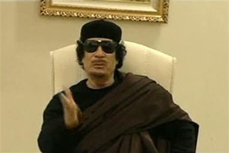 Muammar Gaddafi gestures as he speaks at a Tripoli hotel in this still image from a video by Libyan TV released May 11, 2011. REUTERS/Libyan TV via Reuters TV