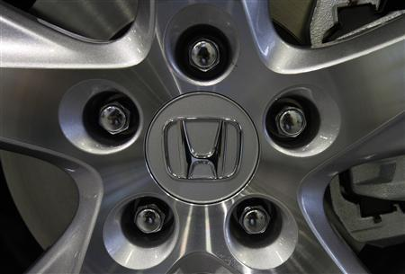 A logo of Honda Motor on a wheel is pictured at its showroom in Tokyo May 17, 2011. REUTERS/Yuriko Nakao