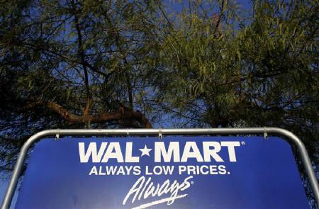 The Wal-Mart logo is seen on a sign in Phoenix, Arizona, February 18, 2010. Wal-Mart Stores Inc posted a bigger-than-expected jump in quarterly profit on Tuesday, as strength overseas mitigated the continued pressure it felt in the United States, where its same-store sales have now fallen for two years. REUTERS/Joshua Lott/Files