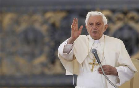 Pope Benedict XVI blesses as he leads his Weekly General Audience in Saint Peter's Square at the Vatican May 18, 2011. REUTERS/Alessandro Bianchi