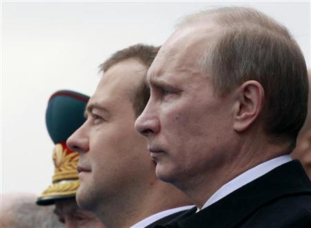 Russia's President Dmitry Medvedev (L) and Prime Minister Vladimir Putin watch a military parade in Red Square on the Victory Day in Moscow May 9, 2011. REUTERS/Sergei Karpukhin