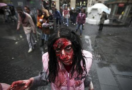 An actor dressed as a zombie walks on a street in downtown Belgrade October 26, 2010, as part of a promotional campaign for an upcoming U.S. TV series called ''The Walking Dead''. REUTERS/Marko Djurica