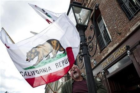 A man hangs California's state flag in Nevada City, California in this May 16, 2011 file photo. REUTERS/Max Whittaker