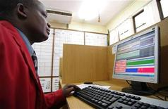 <p>A trader looks at his screen in the trading room of the Dar es Salaam Stock Exchange in Tanzania, January 11, 2010. REUTERS /Katrina Manson</p>