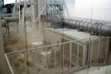 Water rushes into Tokyo Electric Power Co. (TEPCO)'s Fukushima Daiichi nuclear power plant, after a tsunami triggered by an earthquake, in Fukushima, in this handout photo taken March 11, 2011, from the fourth floor of the radioactive waste disposal building, and released by TEPCO on May 19, 2011. REUTERS/Tokyo Electric Power Co/Handout