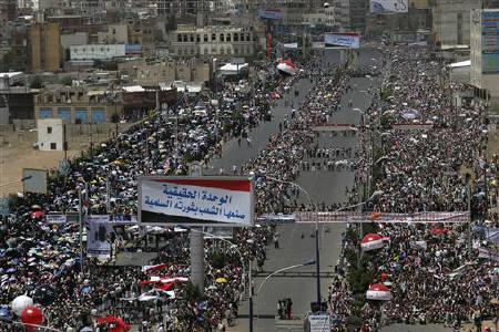 Anti-government protesters attend a ceremony in Sanaa May 22, 2011. Armed Yemeni government loyalists trapped Arab and Western diplomats inside an embassy on Sunday to block the signing of a political accord that would unseat President Ali Abdullah Saleh, witnesses said. REUTERS/Khaled Abdullah