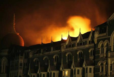 Smoke and fire billows out of the Taj Hotel in Mumbai November 27, 2008. REUTERS/Jayanta Shaw/Files