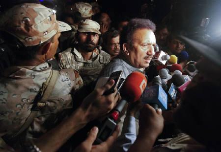 Pakistan's Interior Minister Rehman Malik speaks to the media outside Mehran naval aviation base, which was attacked by militants, in Karachi May 23, 2011. REUTERS/Athar Hussain