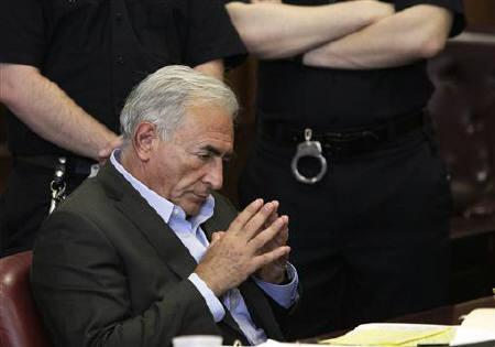 Former IMF chief Dominique Strauss-Kahn gestures during his bail hearing inside of the New York State Supreme Courthouse in New York May 19, 2011. REUTERS/Richard Drew/Pool