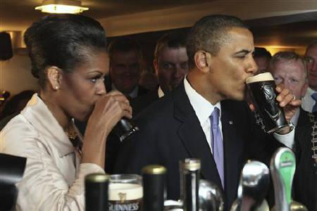 U.S. President Barack Obama and first lady Michelle Obama drink Guinness in Ollie Hayes Pub in Obama's ancestral home in Moneygall May 23, 2011. REUTERS/Maxwell's/Pool