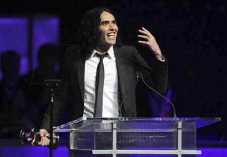 British actor Russell Brand gestures while accepting his award for Comedy Star of the Year during CinemaCon, the official convention of the National Association of Theatre Owners, in Las Vegas, Nevada March 31, 2011. REUTERS/Steve Marcus
