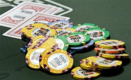 Chips and cards are shown on a poker table during the first day of the 41st annual World Series of Poker no-limit Texas Hold 'em main event at the Rio hotel-casino in Las Vegas, Nevada July 5, 2010. REUTERS/Las Vegas Sun/Steve Marcus