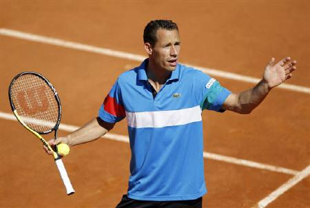 Michael Llodra of France reacts during his match against Steve Darcis of Belgium during the French Open tennis tournament at the Roland Garros stadium in Paris May 23, 2011.  REUTERS/Charles Platiau