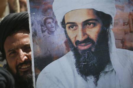 A supporter of the Pakistani religious party Jamiat-e-ulema-e-Islam holds an image of al-Qaeda leader Osama bin Laden during an anti-U.S. rally on the outskirts of Quetta May 6, 2011. REUTERS/Naseer Ahmed/Files