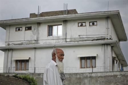 A resident walks past the compound where U.S. Navy SEAL commandos reportedly killed al Qaeda leader Osama bin Laden in Abbottabad May 5, 2011. REUTERS/Akhtar Soomro/Files