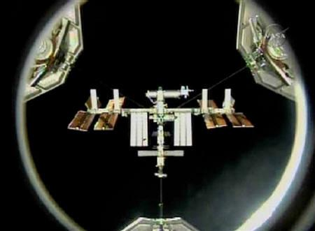 The International Space Station is visible from the space shuttle Discovery prior to the two crafts docking in this image from NASA TV April 7, 2010.  REUTERS/NASA TV/Files
