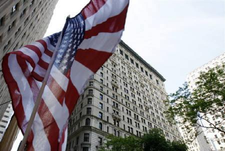 An American flag is seen in front of the building where Dominique Strauss-Kahn is currently staying on house arrest in New York City May 21, 2011. REUTERS/Jessica Rinaldi