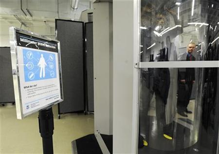 Transportation Security Administration employees participate in a demonstration of new body scanner software that uses a stick figure to represent the passenger being scanned, rather than an actual image of the person, at the TSA Systems Integration Facility at Washington's Reagan National Airport in Arlington, Virginia, February 1, 2011. REUTERS/Jonathan Ernst