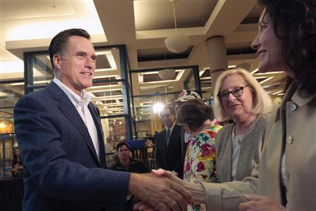 Former Massachusetts Governor Mitt Romney (L) greets supporters during the Greater Des Moines Partnership's Presidential Forum Speaker Series at the Des Moines Historical Building May 27, 2011. REUTERS/Brian C. Frank