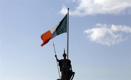 The Irish flag flies above the General Post Office on O'Connell Street, in Dublin, Ireland November 27, 2010.  REUTERS/Cathal McNaughton/Files