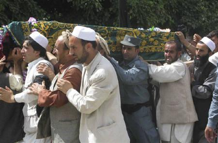 Mourners carry the coffin of north Afghanistan police chief General Dawood Dawood, who was killed by a suicide bomber on Saturday, in Takhar province May 29, 2011. REUTERS/Wahdat