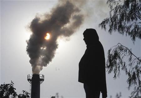 A smoke rises from a chimney of a garbage processing plant on the outskirts of the northern Indian city of Chandigarh December 8, 2010. REUTERS/Ajay Verma