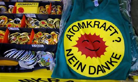 Accesories for anti-nuclear protesters are on sale during an anti-nuclear demonstration in Frankfurt May 28, 2011. Words read ''Nuclear power? No thank you''.  REUTERS/Kai Pfaffenbach