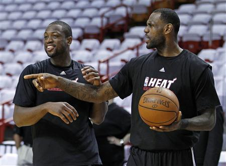 Miami Heat's Dwyane Wade (L) and teammate LeBron James joke during practice as they prepare for the NBA basketball finals in Miami May 30, 2011. The Heat face the Dallas Mavericks in Game 1 on Tuesday. REUTERS/Hans Deryk
