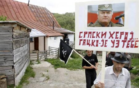 Supporters of Bosnian Serb wartime general Ratko Mladic leave the house where Mladic was born in in his birth village Bozinovici May 29, 2011. REUTERS/Dado Ruvic/Files