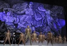 <p>Dancers perform on stage at the start of Kanye West's performance during the last concert on the main stage of the Coachella Valley Music & Arts Festival in Indio, California April 17, 2011. REUTERS/Mike Blake</p>