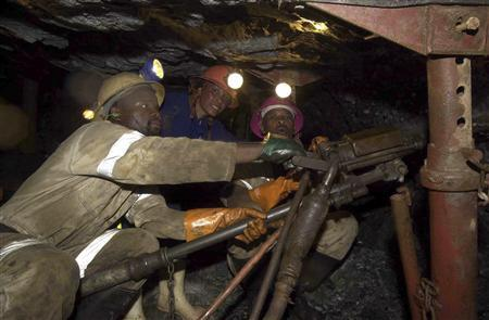 Miners work deep underground at Anglogold Ashanti's Mponeng mine in this undated handout photo. REUTERS/Anglogold Ashanti/Handout