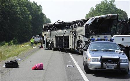 A Virginia State Patrol cruiser sits in front of the aftermath of an early-morning bus crash that killed four people, in the northbound lanes of Interstate 95 in Carmel Church, Virginia, May 31, 2011. REUTERS/Jonathan Ernst