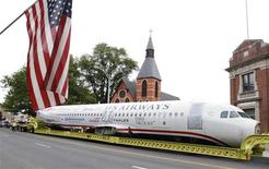 "<p>U.S. Airways flight 1549 also known as the ""Miracle on the Hudson"" is hauled on a truck through the streets in Elizabeth, New Jersey, June 4, 2011. REUTERS/Gary Hershorn</p>"