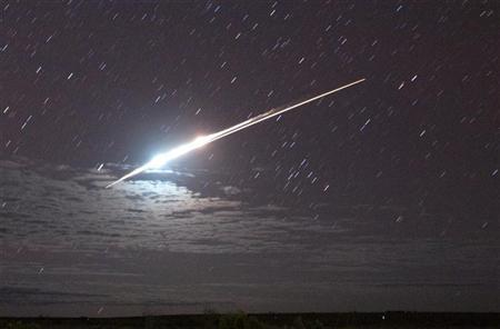 The successful re-entry of the Japanese space probe Hayabusa causing a bright streak in the night sky, is seen from Glendambo in the Australian outback June 13, 2010. REUTERS/Wakayama University Institute for Education on Space/Handout