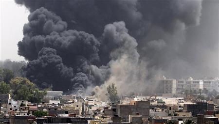 Smoke rises after coalition air strikes in Tripoli, June 7, 2011. REUTERS/Stringer
