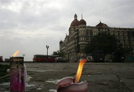 Candles placed for victims of the Mumbai attacks are seen in front of the Taj Mahal Hotel in Mumbai November 30, 2008.    REUTERS/Jayanta Shaw/Files
