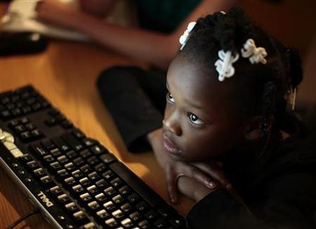 Jayla studies on a computer at the shelter where she lives in Los Angeles, California February 9, 2011. REUTERS/Lucy Nicholson