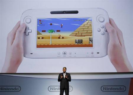 Reggie Fils-Aim, president of Nintendo of America, presents the new Wii U controller at a media briefing during the Electronic Entertainment Expo, or E3, in Los Angeles June 7, 2011. REUTERS/Mario Anzuoni