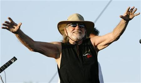 Singer Willie Nelson greets fans before the start of his performance at the Coachella Music Festival in Indio, California April 29, 2007. REUTERS/Mario Anzuoni