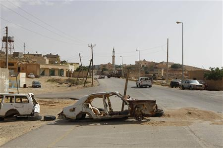 A view of an empty street in the Libyan town of Kalaa, which fell to rebels earlier this week and bombed by the forces of Libya's leader Muammar Gaddafi, in the Western Mountains, some 90 km (60 miles) southwest of the capital Tripoli, June 8, 2011. REUTERS/Youssef Boudlal