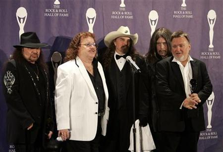 Members of the band Lynyrd Skynyrd (L-R) Gary Rossington, Billy Powell, Artimus Pyle, Bob Burns, and Ed King pose backstage at the Rock and Roll Hall of Fame induction ceremony at the Waldorf Astoria Hotel in New York, March 13, 2006. REUTERS/Brendan McDermid