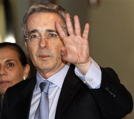 Colombia's former president Alvaro Uribe waves at the media as he attends a business forum in Panama City November 25, 2010. REUTERS/Alberto Lowe