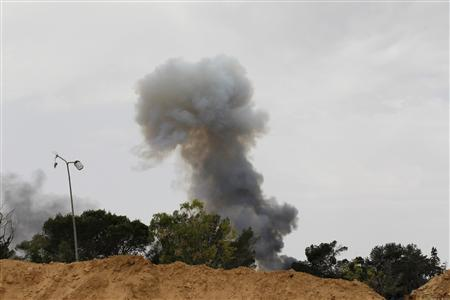 Smoke rises after an explosion, the cause of which was unclear, on Misrata's western front line June 11, 2011. REUTERS/Zohra Bensemra