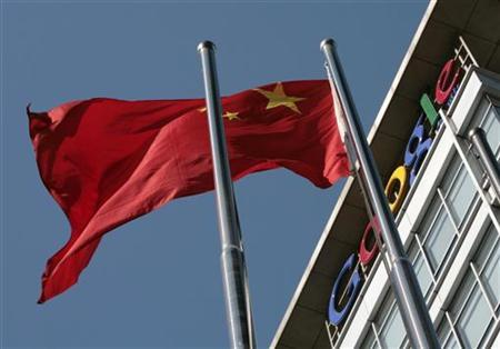 A Chinese national flag flies in front of Google China's headquarters in Beijing January 15, 2010. REUTERS/Alfred Jin