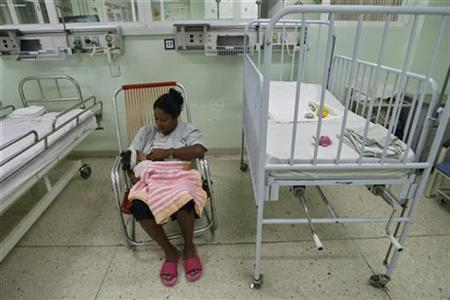 A mother breastfeeds her child in a room at the William Soler Pediatric Cardiology Center in Havana October 21, 2008. REUTERS/Enrique De La Osa